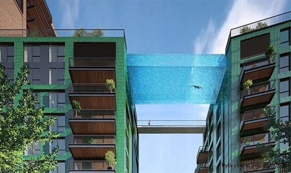 """英国伦敦九榆树区(Nine Elms)将在两座居民楼间建造一个透明悬空的""""天空游泳池"""",高约110英"""